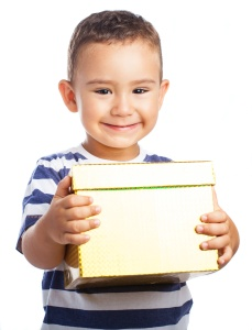 happy child with a present on white background