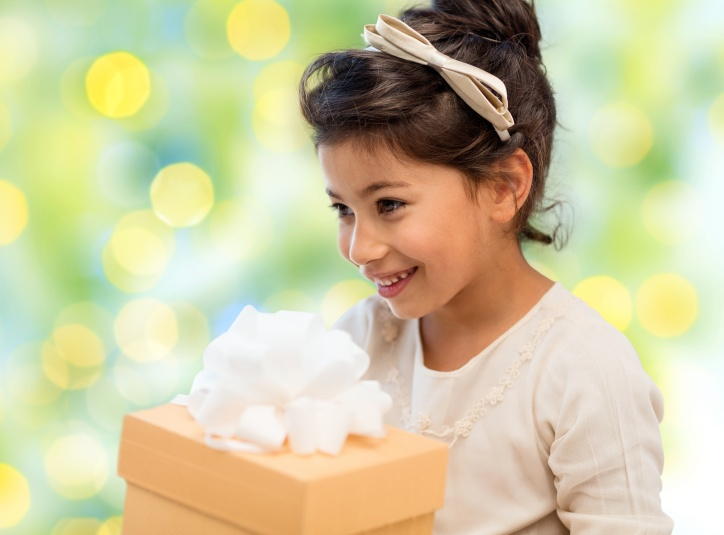 happy little girl with gift box