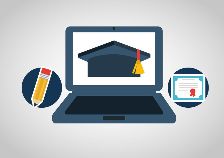 computer with graduation cap on screen